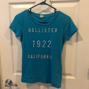 Hollister XS Turquoise T-shirt with silver letters